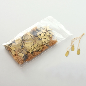 Gold jewelry tags with marker pen