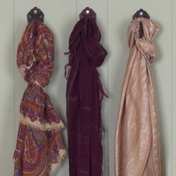 Showcase scarves for mom on wall displays